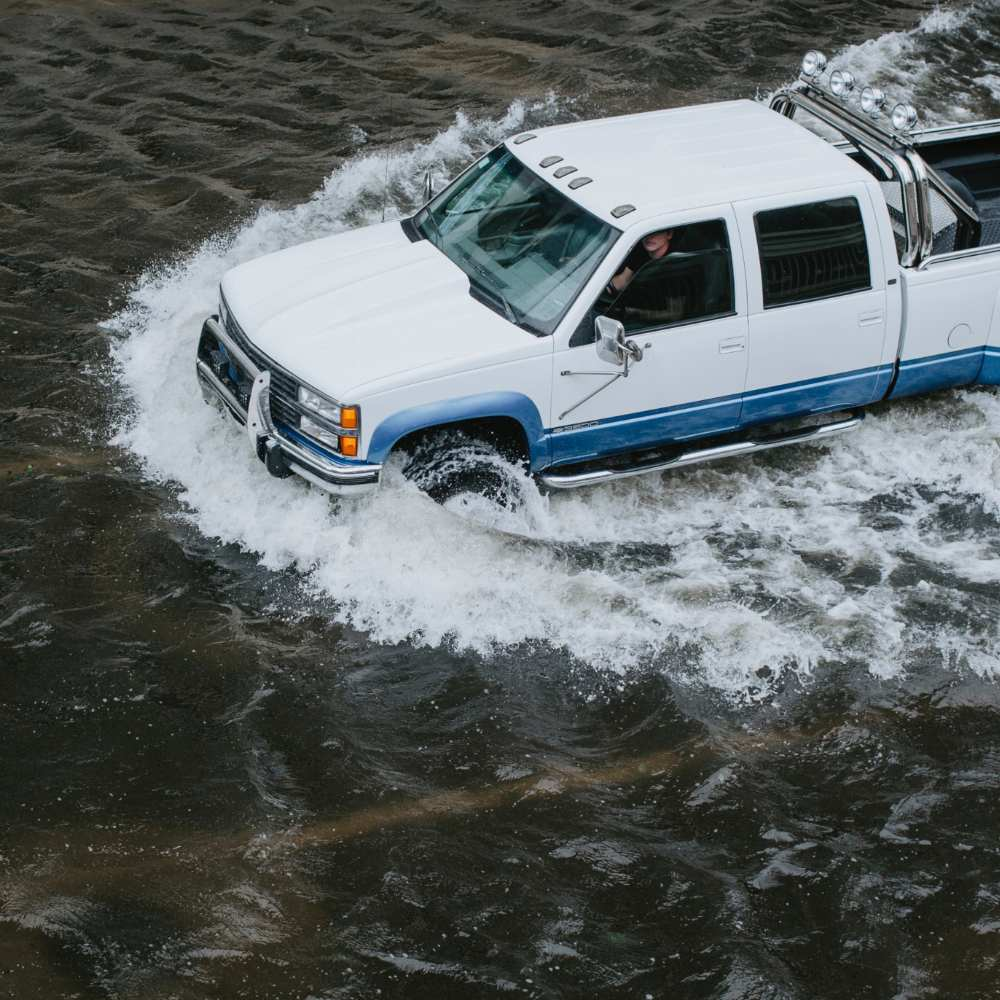 car driving in flood